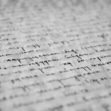 Papier met handgeschreven schrift
